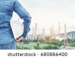 smart woman engineer holding... | Shutterstock . vector #680886400