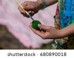 a child holds a green paint and ... | Shutterstock . vector #680890018