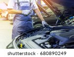 the mechanic hand holding with... | Shutterstock . vector #680890249