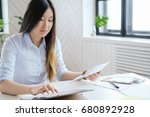 woman at work in the office   Shutterstock . vector #680892928
