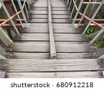 old wooden bridge that link... | Shutterstock . vector #680912218