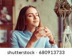 woman enjoying her cup of tea... | Shutterstock . vector #680913733