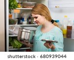 Small photo of upset spanish woman noticed foul smell of food from casserole