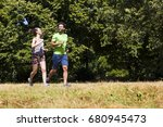 view at young couple running in ... | Shutterstock . vector #680945473