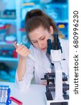 laboratory female assistant... | Shutterstock . vector #680996230