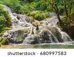 at mele cascades waterfalls a... | Shutterstock . vector #680997583