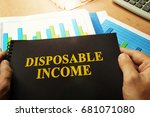 Small photo of Disposable income written on a front of note.