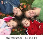 children smiling on autumn grass | Shutterstock . vector #6811114