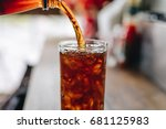 pouring cola water into the... | Shutterstock . vector #681125983