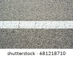 Small photo of New asphalt texture with white dashed line