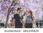 young happy couple walking... | Shutterstock . vector #681244624