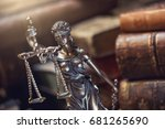 statue of justice with old books