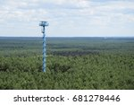 High fire watch tower in the forest