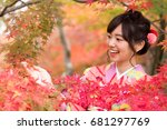 attractive asian woman wearing... | Shutterstock . vector #681297769