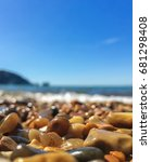 Small photo of Sun-kissed pebbles at the Alum beach, Isle of Wight, UK.