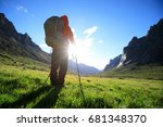 woman with backpack hiking in... | Shutterstock . vector #681348370