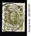Small photo of Russian Empire public circulation postal stamp, denomination 20 kopecks, printed in Russia, circa 1913: A stamp shows Russian Czar ALEXANDER I
