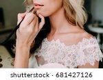young beautiful bride applying... | Shutterstock . vector #681427126