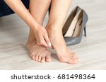 Small photo of Tired and aching female feet after walking