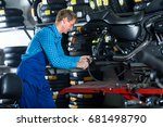 smiling man in coveralls... | Shutterstock . vector #681498790