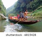Chinese Sampan Ride and American Tourists, China - stock photo