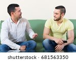 two relaxed men discussing... | Shutterstock . vector #681563350