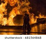 Two Firemen Battling Tanker On...