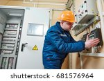electrician at work | Shutterstock . vector #681576964