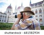 senior pensioner photographing... | Shutterstock . vector #681582934