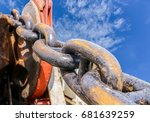 anchor chain, mooring winch foreward under ship in floating drydock in shipyard on blue sky background