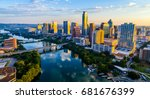 Stock photo austin texas usa sunrise skyline cityscape over town lake or lady bird lake with amazing reflection 681676399
