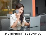 young business woman with laptop | Shutterstock . vector #681690406