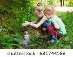 two girls near a creek. | Shutterstock . vector #681744586