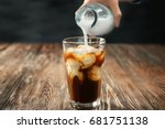 pouring milk into glass of cold ... | Shutterstock . vector #681751138