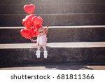 Adorable Little Girl Holding...