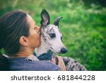 woman kissing her cute dog. the ... | Shutterstock . vector #681844228
