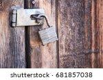 broken lock on a wooden door | Shutterstock . vector #681857038