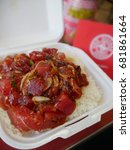Small photo of Ahi Tuna Poke Bowl in a takeout container in Oahu, Hawaii.