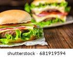 two homemade full cheeseburgers ...   Shutterstock . vector #681919594