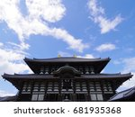 Small photo of NARA JAPAN - JUL 21: A traditional buddhist temple stands on the sunny day of July 21, 2017 in Nara. Japanese temples are made of blacken woods and ceramic tiles.