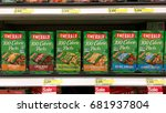 Small photo of Alameda, CA - July 21, 2017: Grocery store shelf with Emerald brand 100 calorie snack packs. Dry roasted almonds, cocoa roasted almonds, dill pickle cashews, cashew halves and pieces, natural almonds