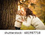 mother and child kissing in at... | Shutterstock . vector #681987718