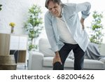 old man with back pain | Shutterstock . vector #682004626