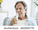 old man with tooth sensitivity | Shutterstock . vector #682004770
