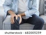 Old Man Suffering From Knee...
