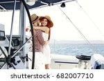 two lovers and yacht  | Shutterstock . vector #682007710