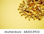 gold jewelry on gold background ... | Shutterstock . vector #682013923