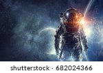 astronaut in outer space. mixed ... | Shutterstock . vector #682024366