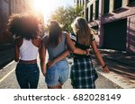 rear view shot of three young... | Shutterstock . vector #682028149