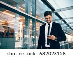businessman using smartphone... | Shutterstock . vector #682028158